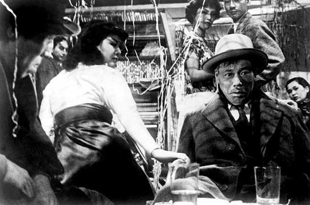 Miki Odagiri as the secretary and Takashi Shimura as the bureaucrat in Akira Kurosawa's Ikiru (To Live; 1952)