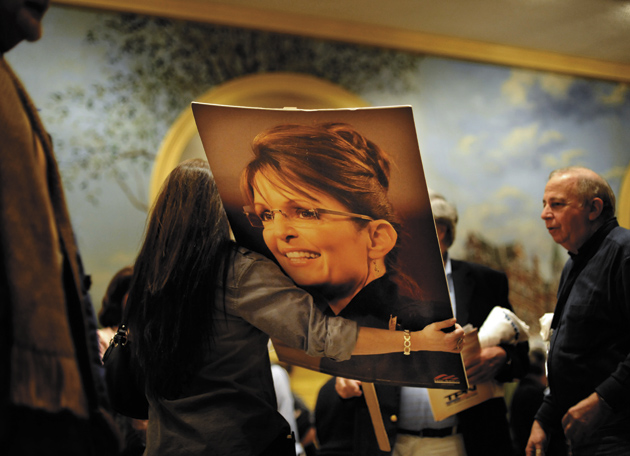 Tania Ashe, a member of Team Sarah from Orlando, Florida, carrying a poster of Sarah Palin at the National Tea Party Convention in Nashville, Tennessee, February 4, 2010
