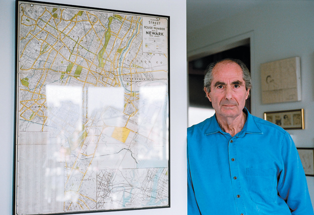 Philip Roth in New York City with an old map of Newark, 2007