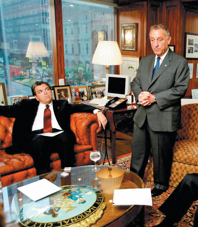 Charles Prince, left, in 2003, when he took over as chief executive of Citigroup after the resignation of Sanford Weill, right