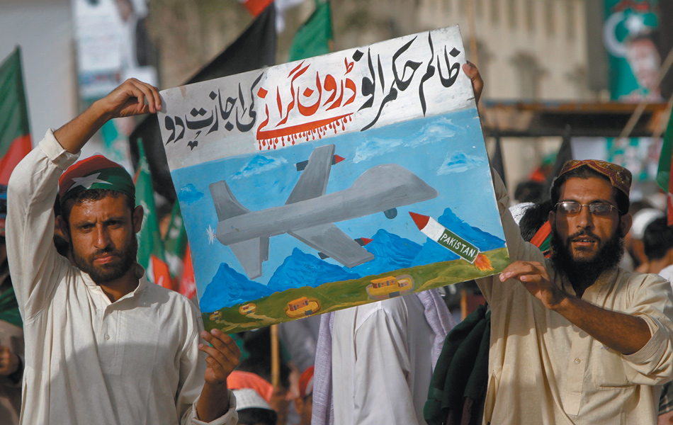 Protesters at a rally against drone attacks, Karachi, Pakistan, May 2011. Their sign says, in Urdu, 'Oh cruel leaders, allow us to shoot down drones.'