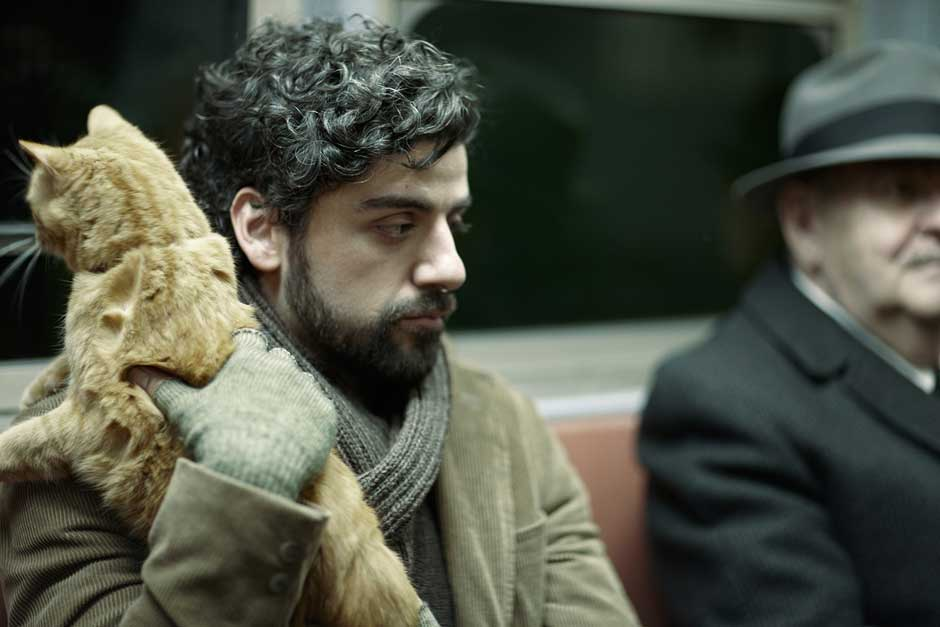 Isaac holding the cat on the train.jpg