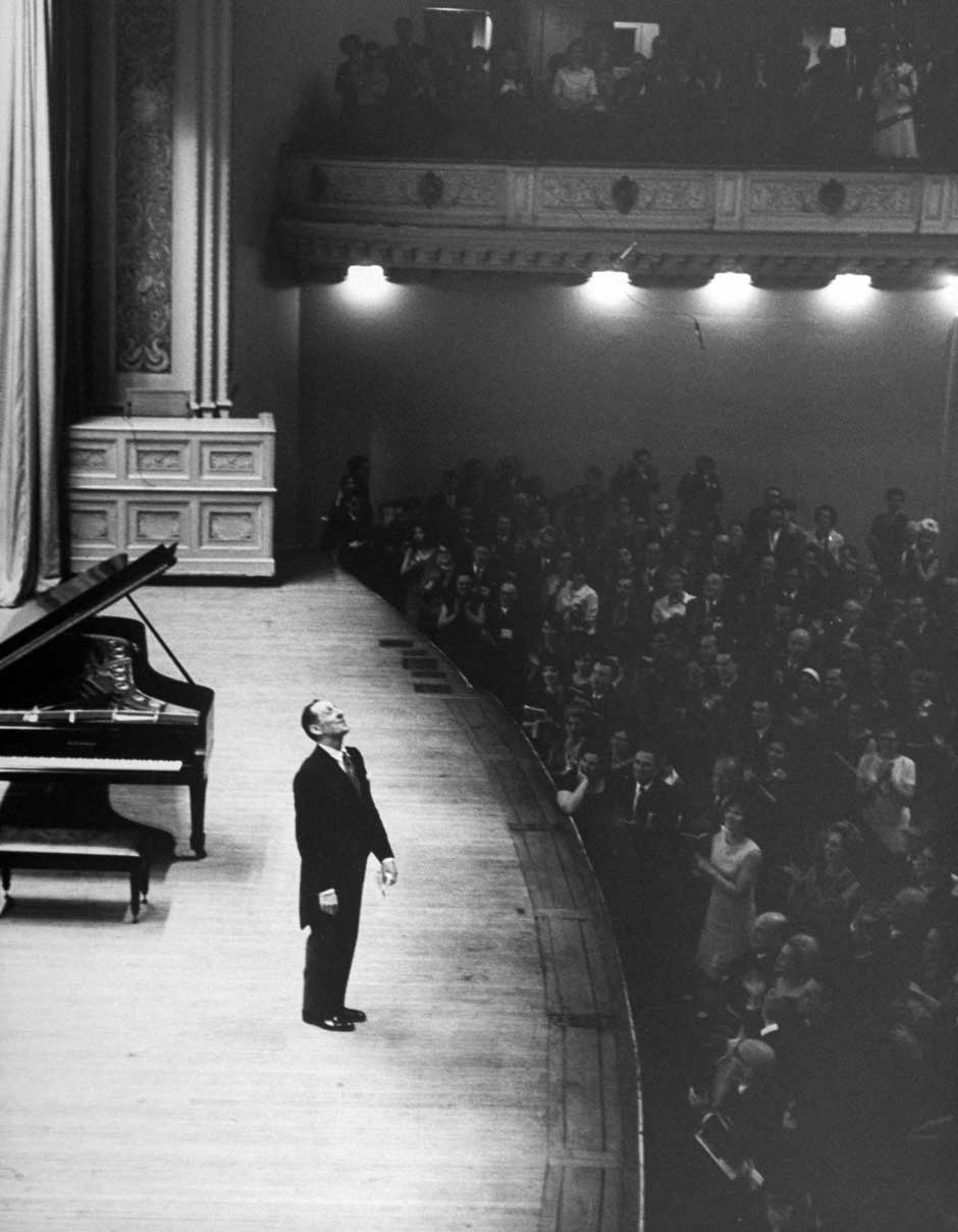 Pianist Vladimir Horowitz receiving a standing ovation upon his return to the concert stage at Carnegie Hall after a twelve-year absence, May 9, 1965