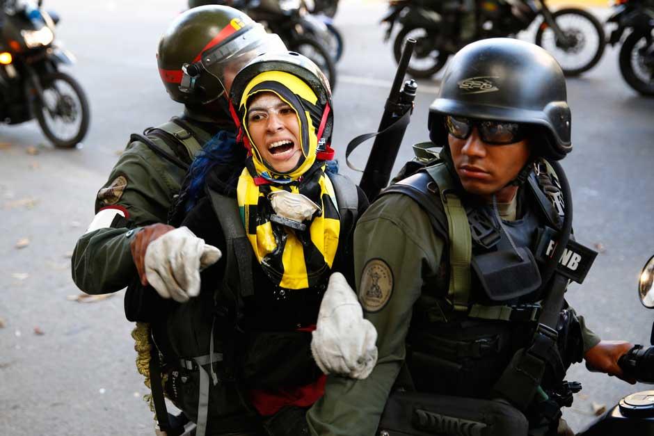 Venezuelan security forces detaining a protester, Caracas, March 16, 2014