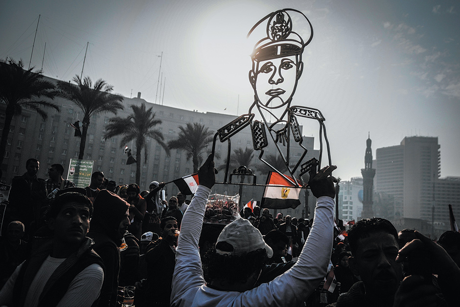Demonstrators with a portrait of General Abdel Fatah el-Sisi—now Egypt's president—at a rally in Tahrir Square, Cairo, January 2014