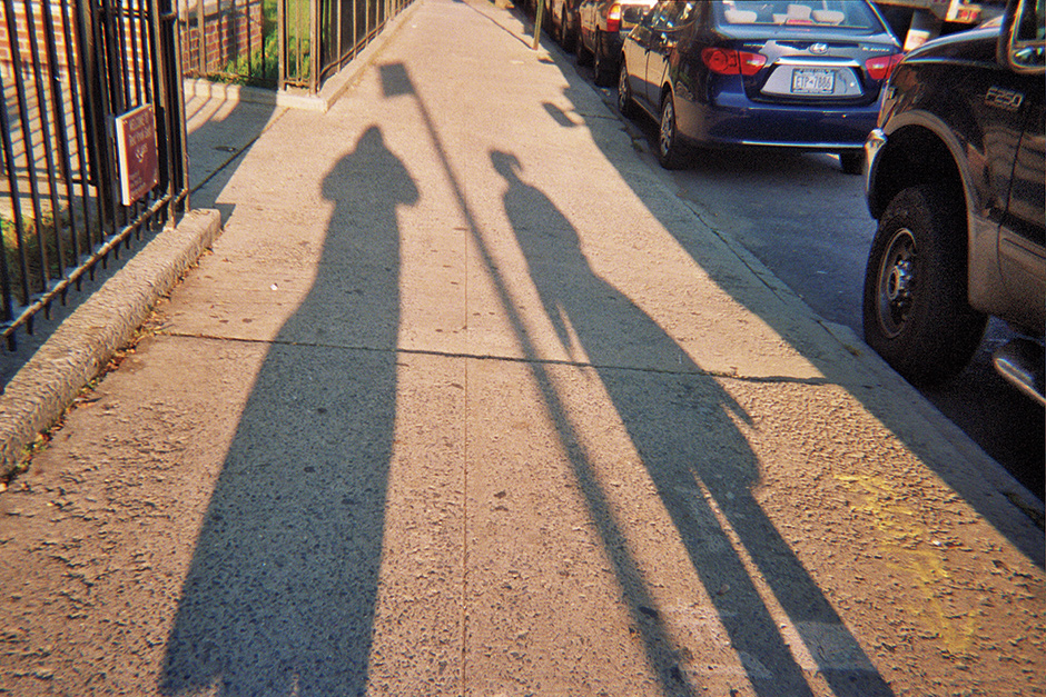 Shadows of residents of a housing project in Red Hook, Brooklyn, 2011; photograph by Jared Wellington, a twelve-year-old workshop participant, from Project Lives: New York Public Housing Residents Photograph Their World. Edited by George Carrano, Chelsea Davis, and Jonathan Fisher, it has just been published by PowerHouse Books.