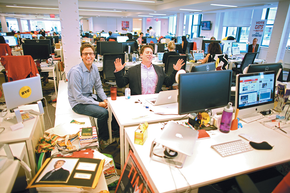 Jonah Peretti (left), cofounder and chief executive of BuzzFeed, with Ben Smith (center), its editor in chief, New York City, August 2014