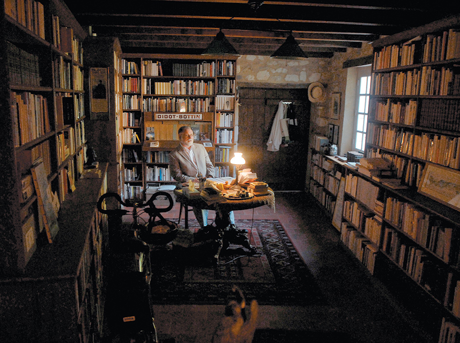 Alberto Manguel in his library near Châtellerault, in southwest France, 2007