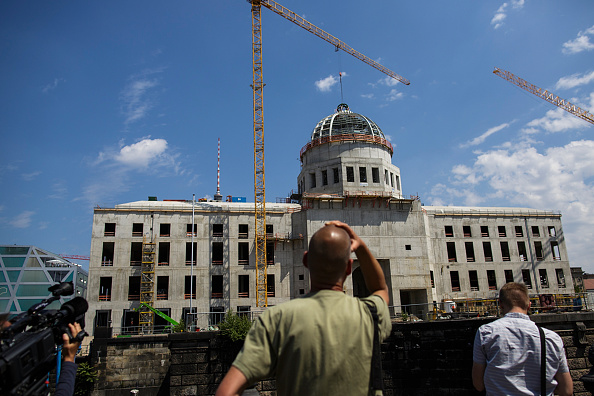 Visitors attend the topping-out ceremony for the Humboldt Forum, Berlin, Germany, June 12, 2015