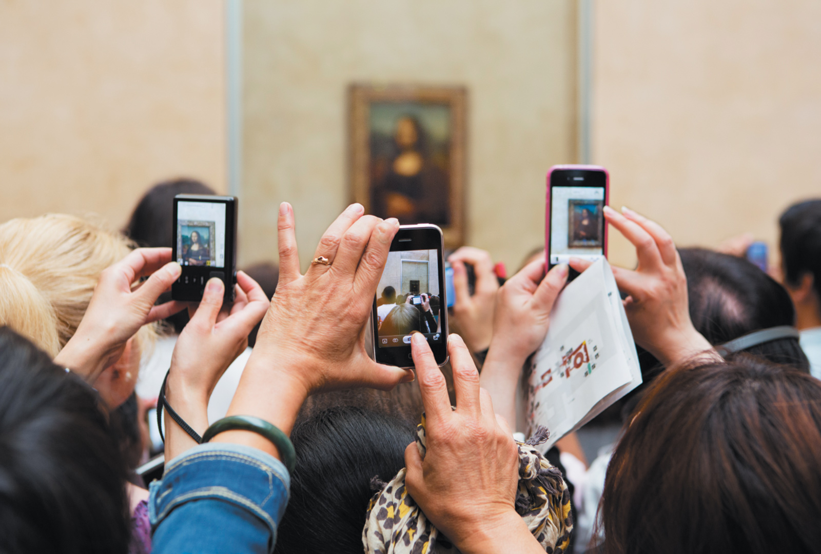 Museumgoers taking photographs of the Mona Lisa at the Louvre, Paris, 2012