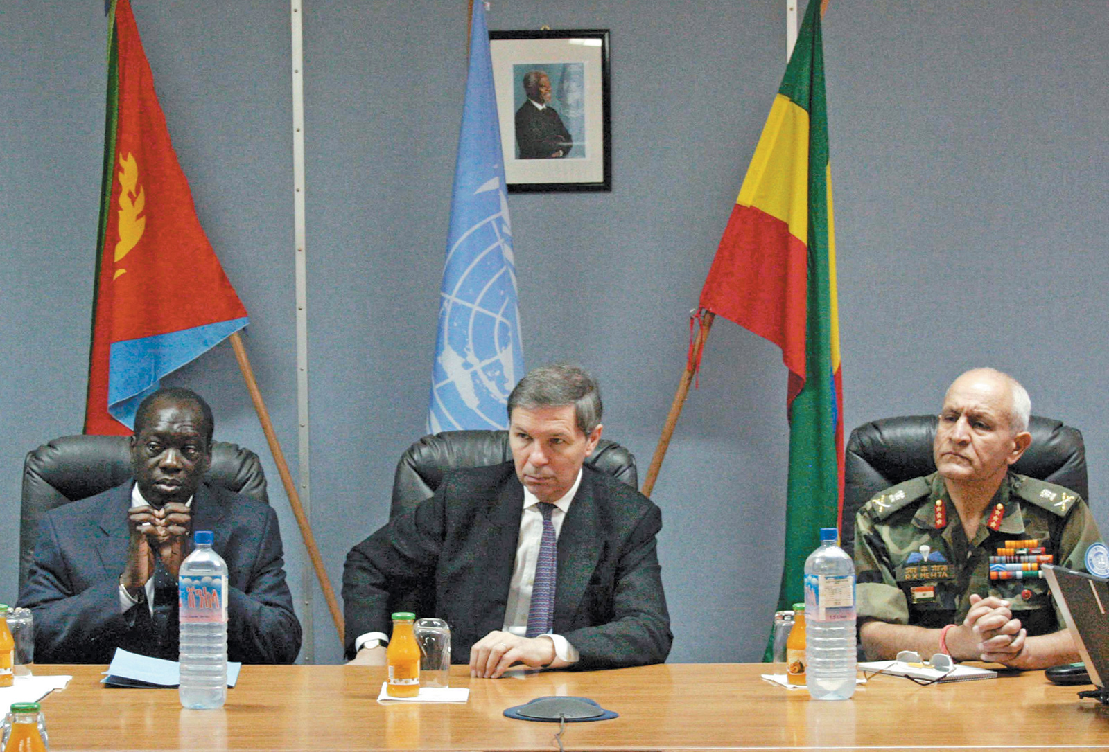 Jean-Marie Guéhenno (center), then the UN's undersecretary-general for peacekeeping operations, at a meeting at the UN Mission in Ethiopia and Eritrea, with deputy special representative Joël Adechi and military adviser Major-General Randhir Kumar Mehta, Asmara, Eritrea, December 2005