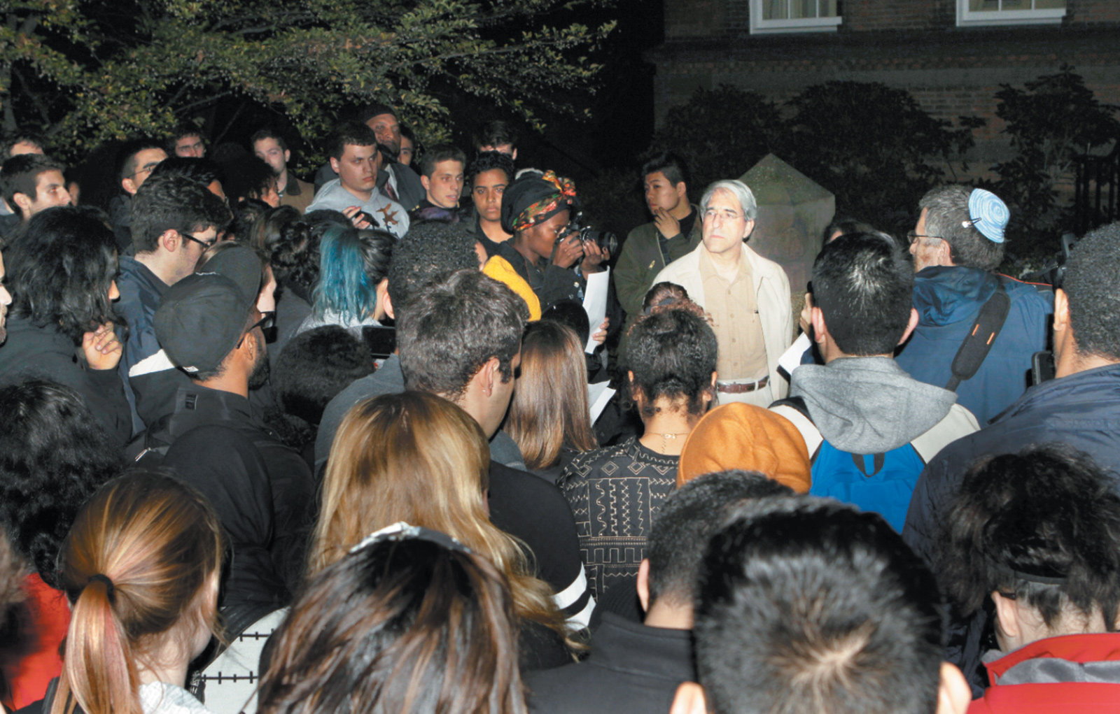 Students reading a set of demands to Yale President Peter Salovey in front of his house, New Haven, Connecticut, November 2015