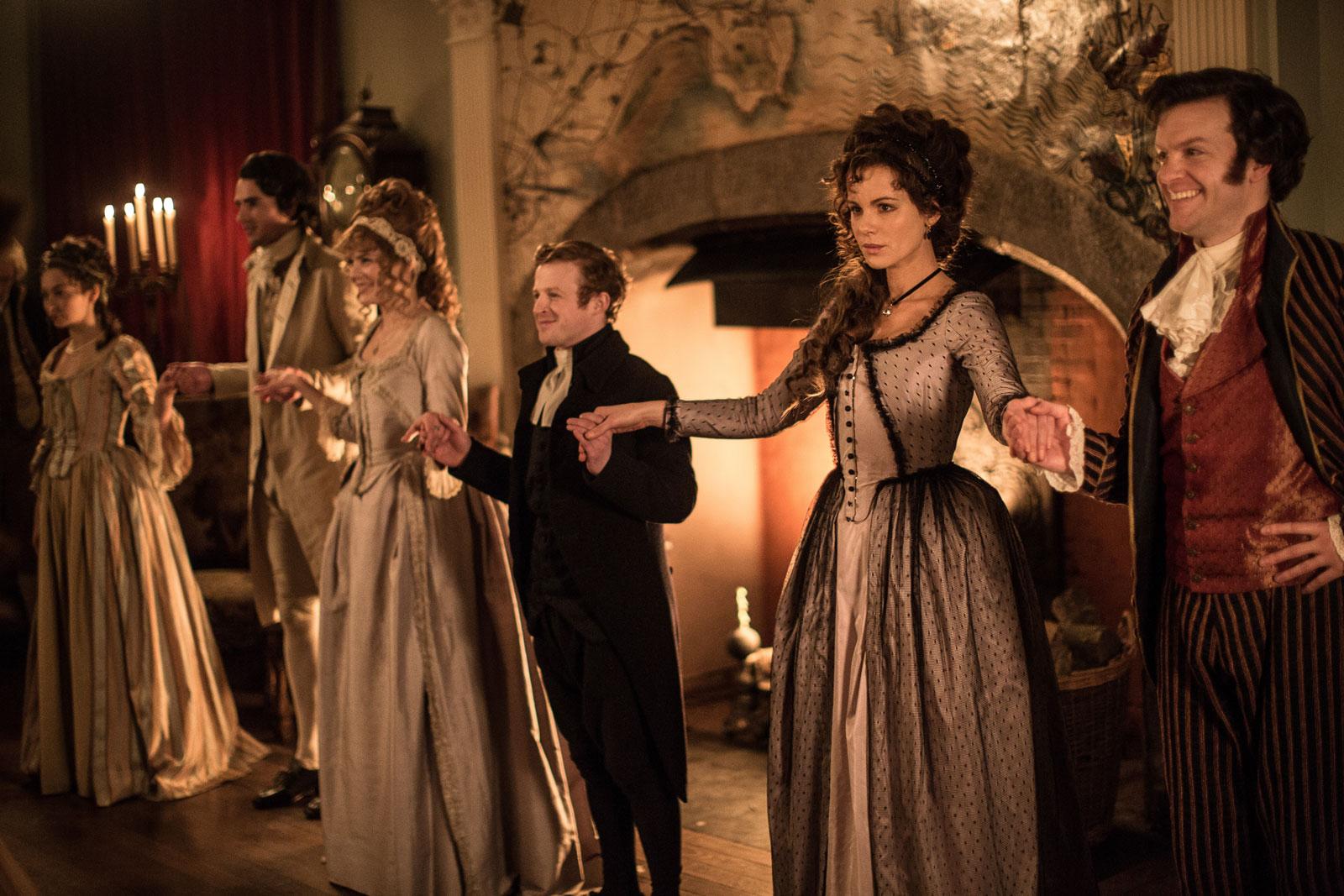 Kate Beckinsale as Lady Susan Vernon (right) and Tom Bennett as Sir James Martin (far right) in Whit Stillman's <em>Love &amp; Friendship</em>, 2016