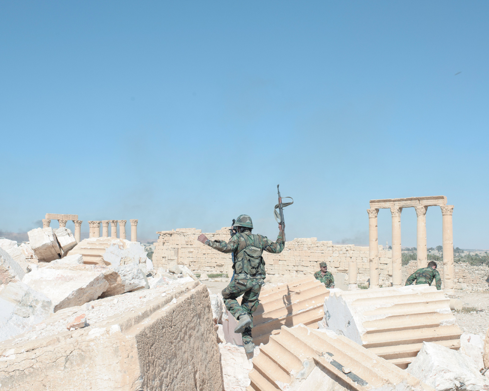 Syrian Army soldiers at the ruins of the Temple of Bel after retaking the destroyed ancient city of Palmyra from Islamic State militants, April 2016