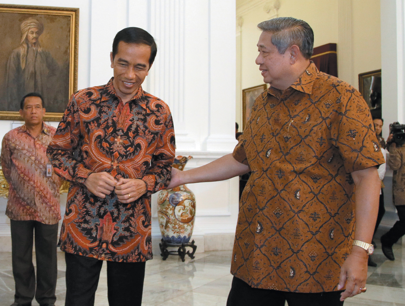 Indonesian President-Elect Joko Widodo (left) receiving a tour of the presidential palace from President Susilo Bambang Yudhoyono the day before Widodo's inauguration, Jakarta, October 2014