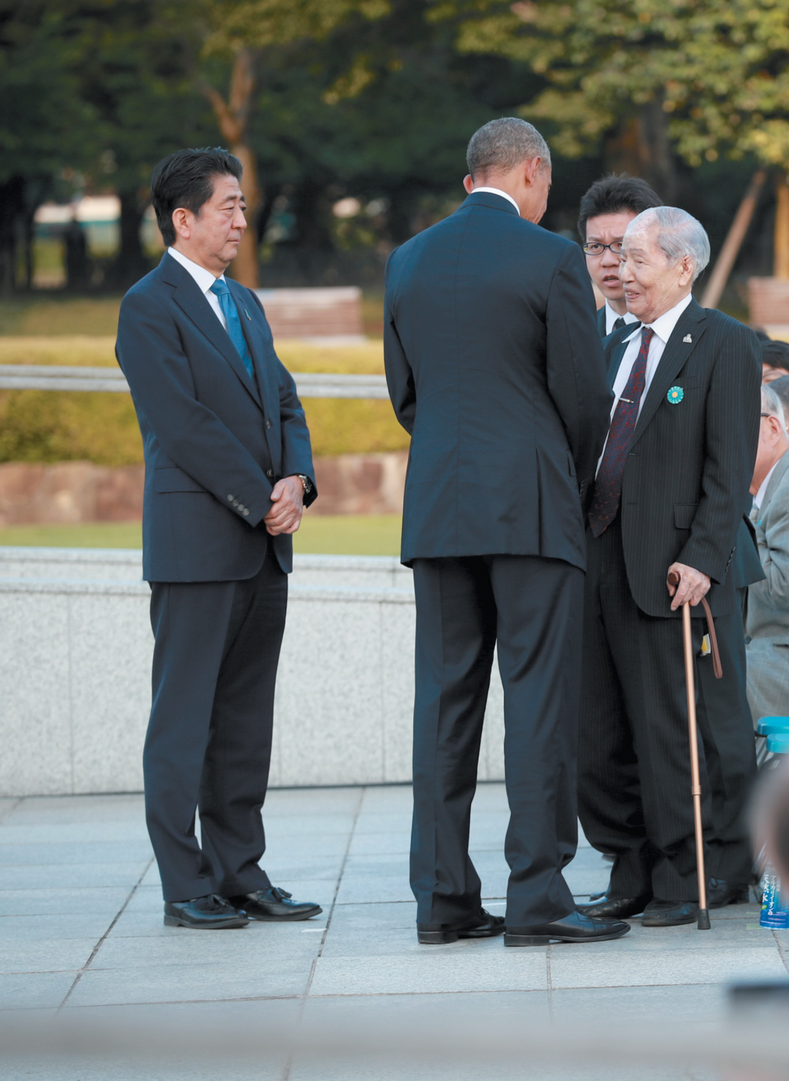 President Obama with Sunao Tsuboi, a survivor of the US's atomic bombing of Hiroshima in 1945, during a ceremony at the Hiroshima Peace Memorial, May 2016. Japanese Prime Minister Shinzo Abe is at left.
