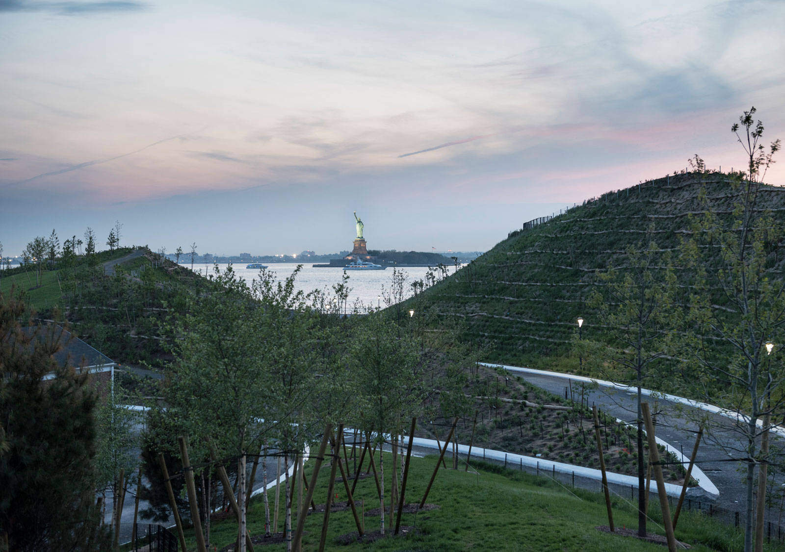 West 8's man-made Discovery and Outlook Hills, with the Statue of Liberty in the distance, Governors Island, New York, 2016