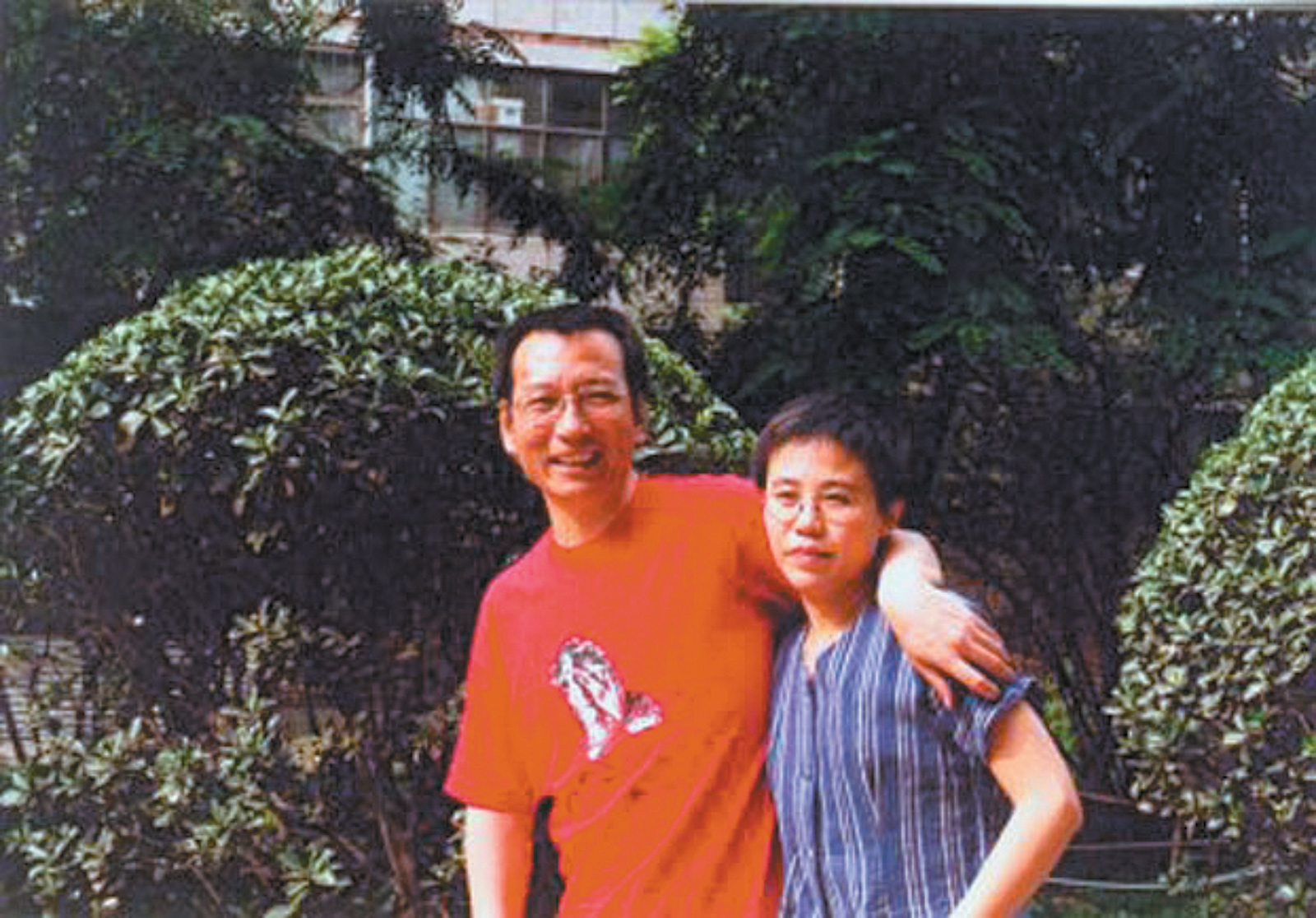 Nobel Peace Prize laureate Liu Xiaobo and his wife Liu Xia in an undated photograph taken before he was sent to prison for 'subversion of state power' after he helped to write Charter 08, a petition that called for 'freedom of speech, freedom of the press, and academic freedom' in China. She remains under house arrest at their apartment in Beijing.