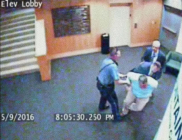 Video footage showing Kansas City Public Library staff member Steve Woolfolk being arrested, May 9, 2016