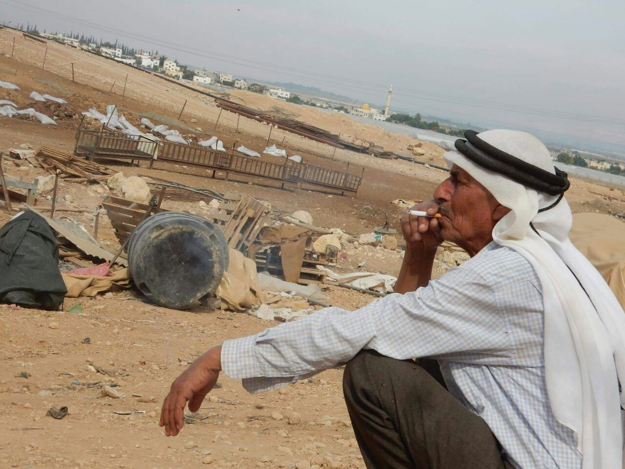 Abu Rasmi Ayyub amidst the ruins of al-Hammeh, 2016
