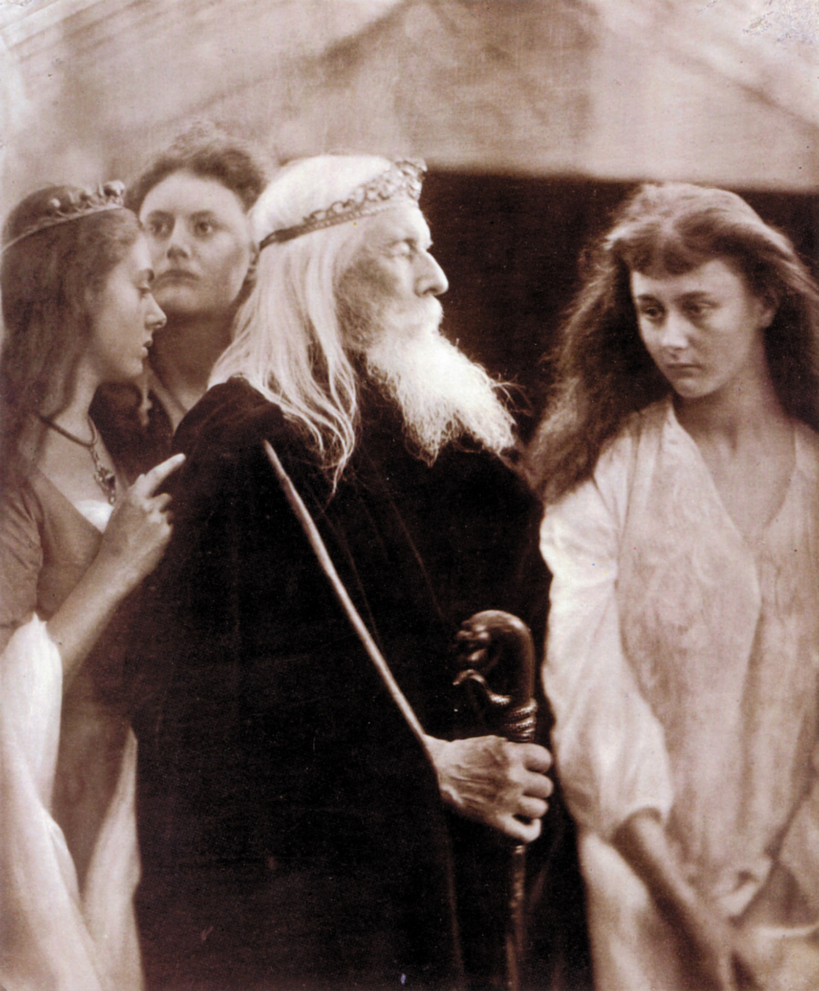 'King Lear Allotting His Kingdom to His Three Daughters'; photograph by Julia Margaret Cameron, 1872. From left are Lorina Liddell, Edith Liddell, Charles Hay Cameron, and Alice Liddell.