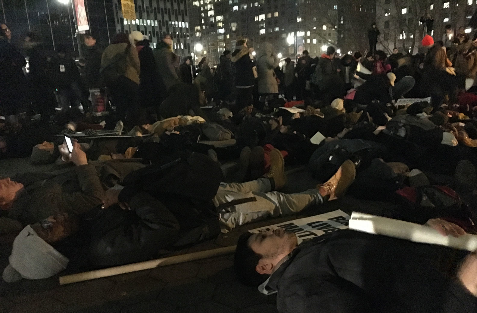 """Protesters participating in a """"die-in"""" during the action on Thursday night, Foley Square, Manhattan, February 2, 2017"""