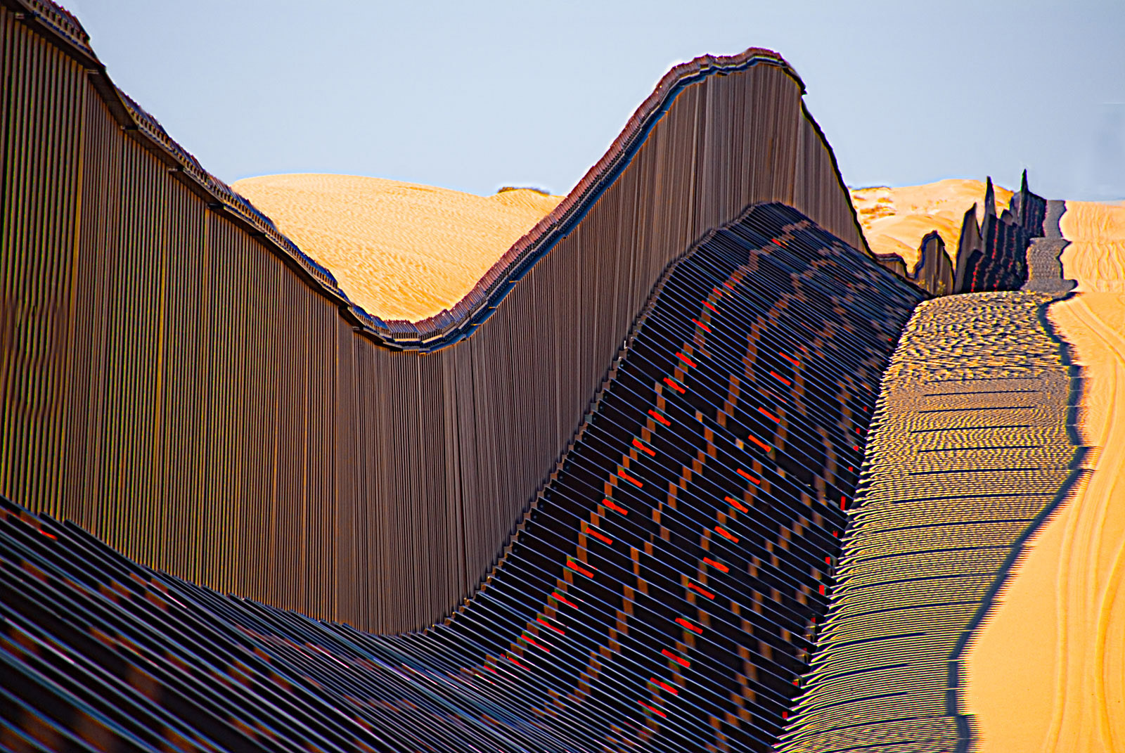 A high-tech adjustable section of the US-Mexico border fence running through the Algodones dunes in California, January 2018
