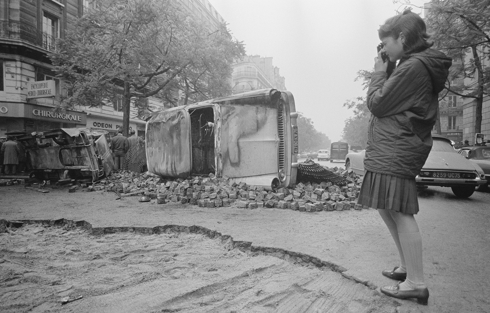 A young Parisian photographing the barricades still in place the morning after riots in May 1968