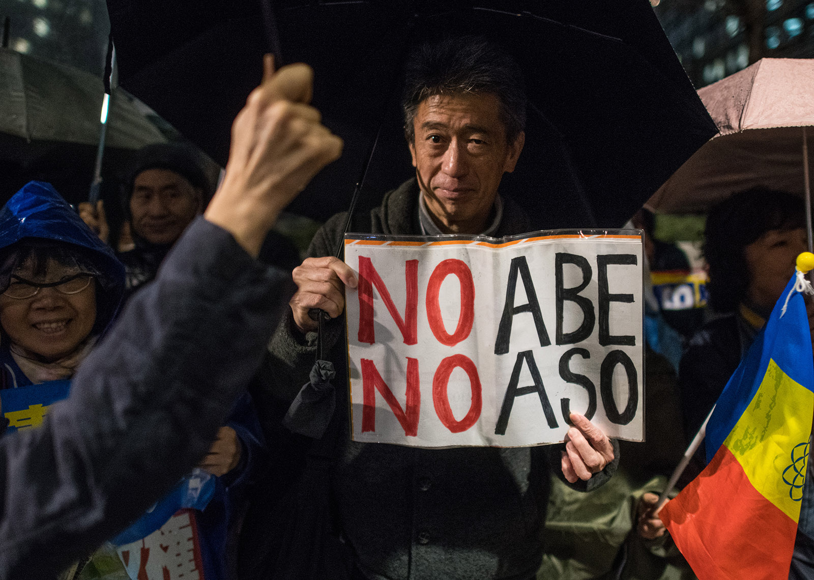 Protesters calling for the resignation of Prime Minister Shinzo Abe and his finance minister, Taro Aso, over a land sale scandal, Tokyo, Japan, March 16, 2018