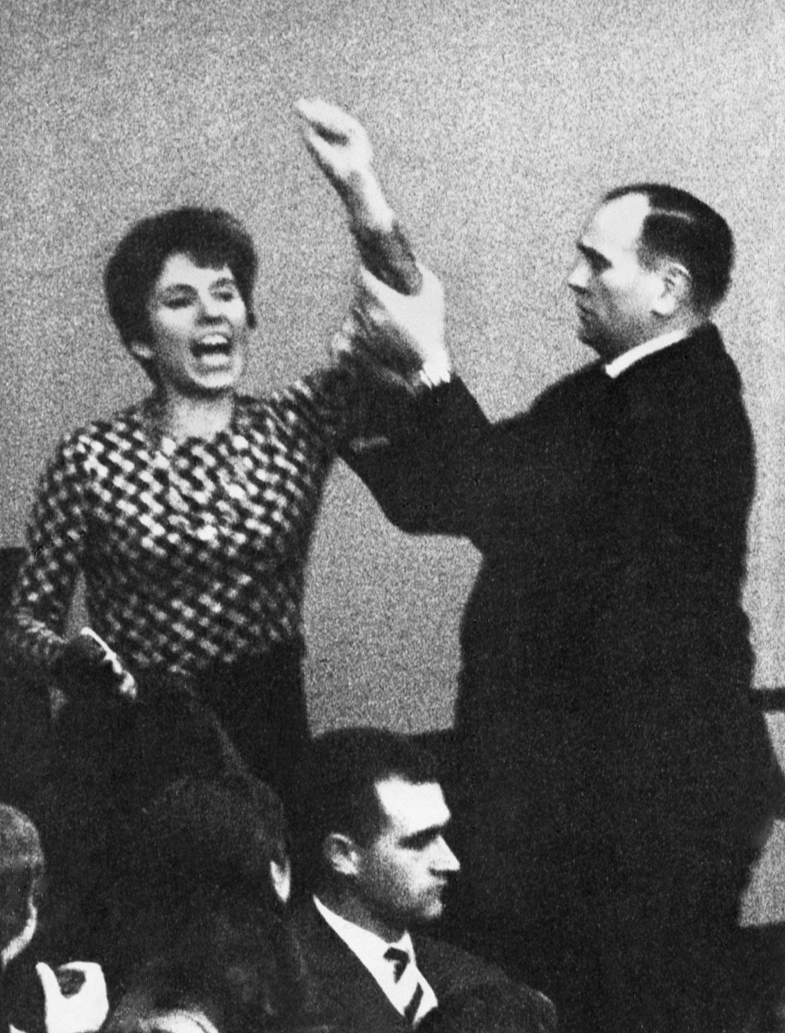 Beate Klarsfeld interrupting the West German chancellor in the Bundestag to shout 'Kiesinger, Nazi, resign!,' Bonn, April 1968