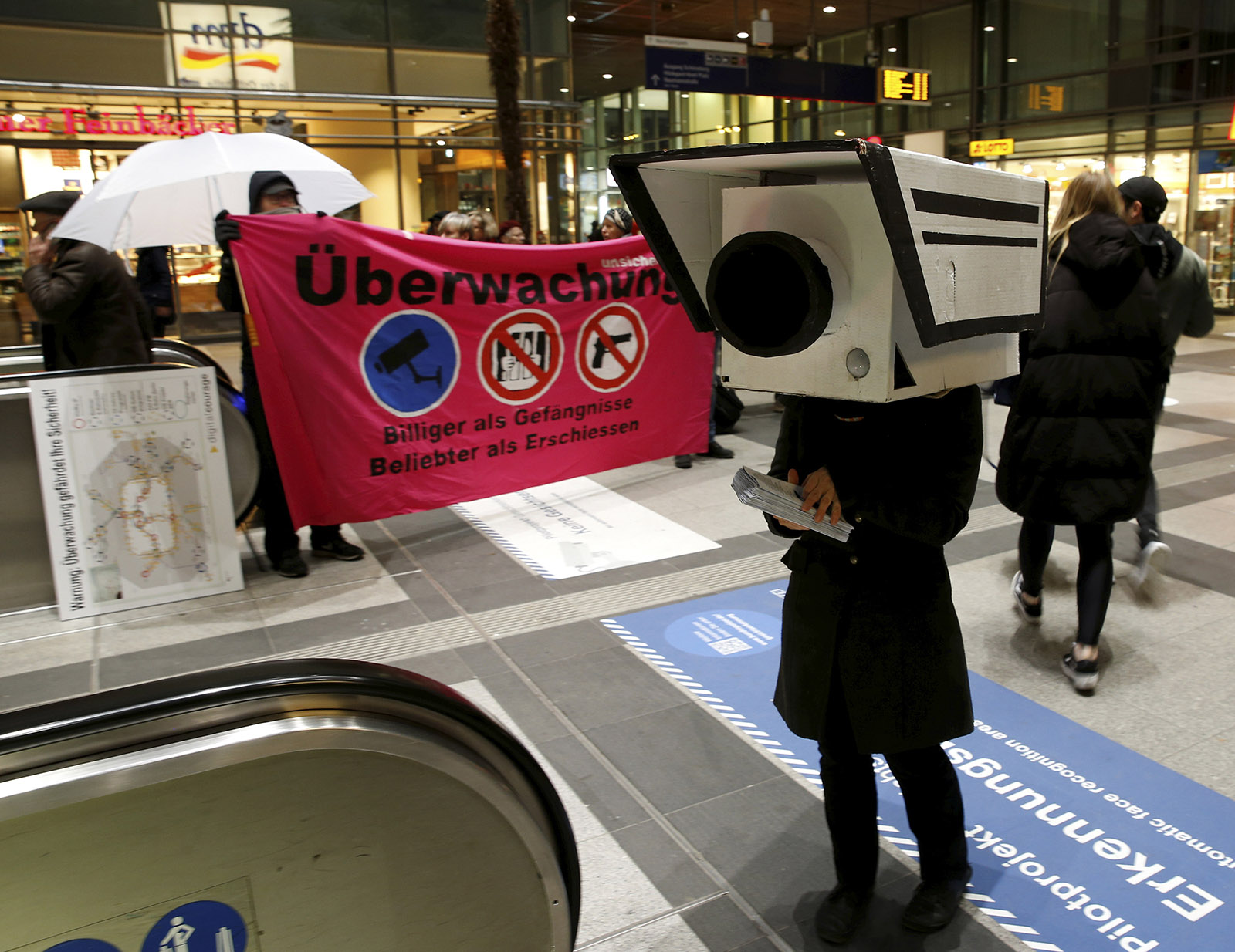 A demonstrator dressed as a security camera at an anti-surveillance protest, Berlin, November 2017