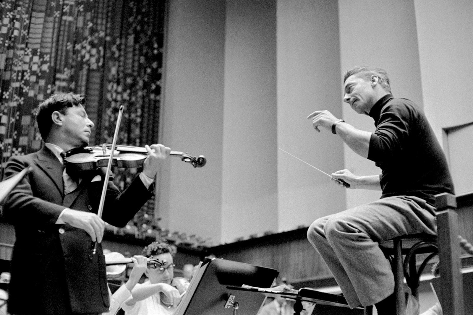 Herbert von Karajan (right) with the violinist Nathan Milstein during a rehearsal, Lucerne, 1957