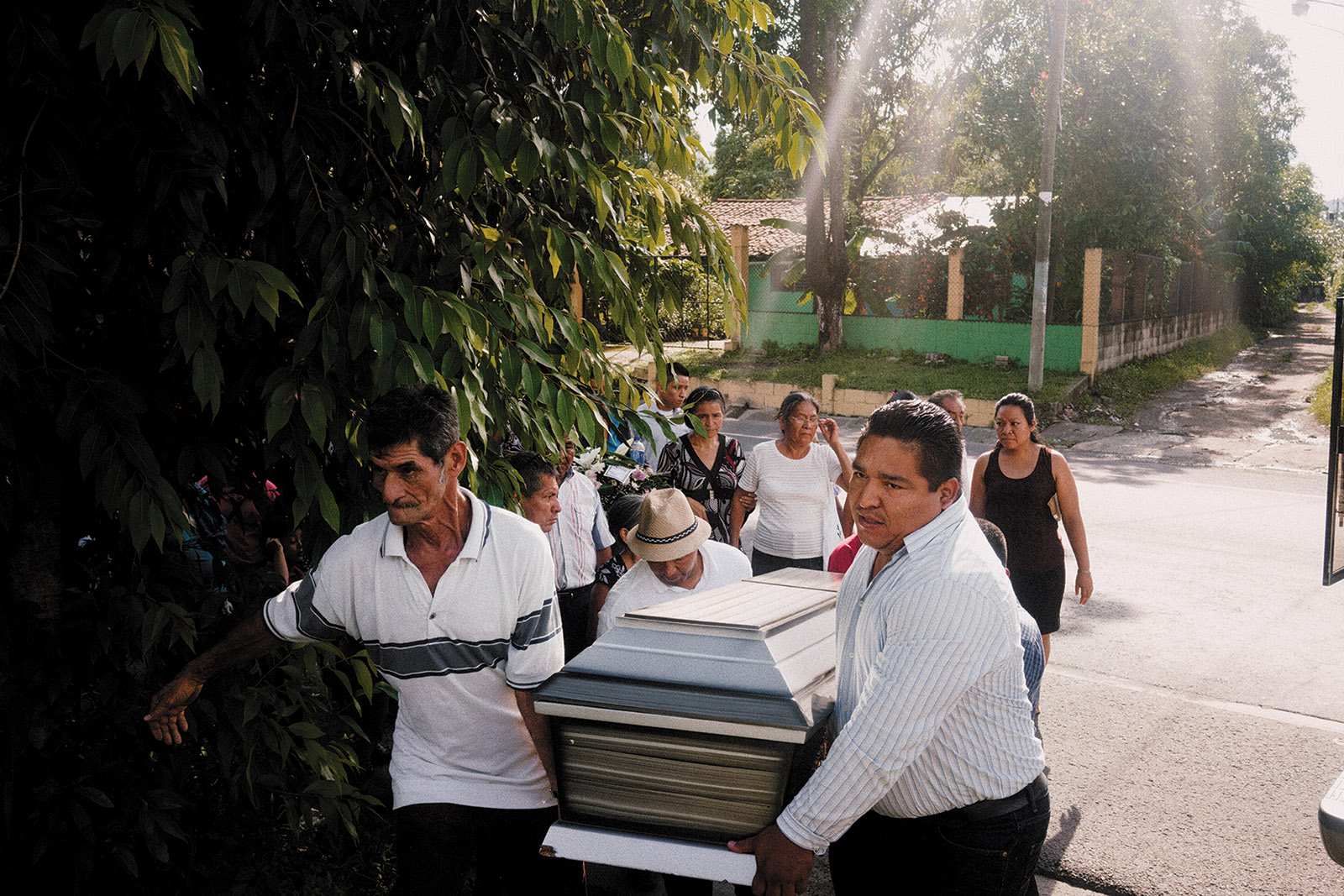 Friends and family at the funeral of a bus driver who was shot and killed during an encounter with a gang member as he was returning from his daily route, Apopa, El Salvador, September 2016