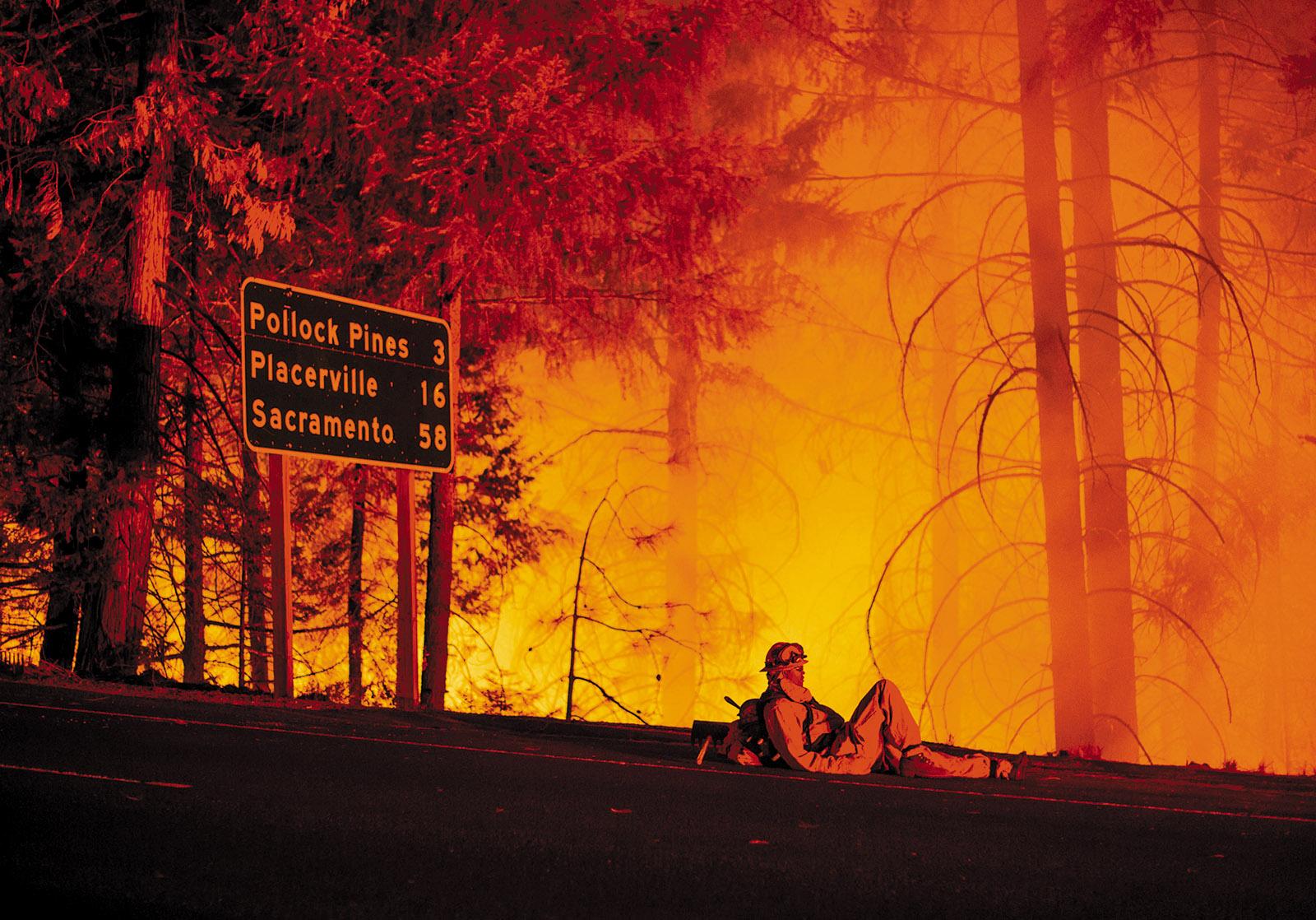 A firefighter taking a break from battling the King Fire, Fresh Pond, California, September 2014