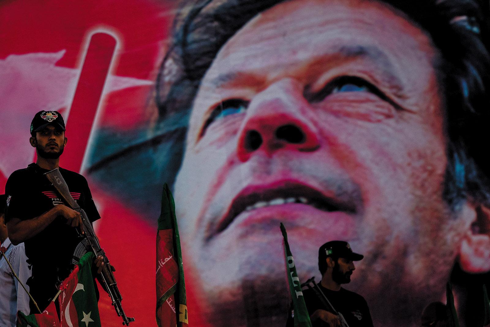 Punjabi police commandos standing guard at a political rally for Imran Khan, Faisalabad, Pakistan, May 2013