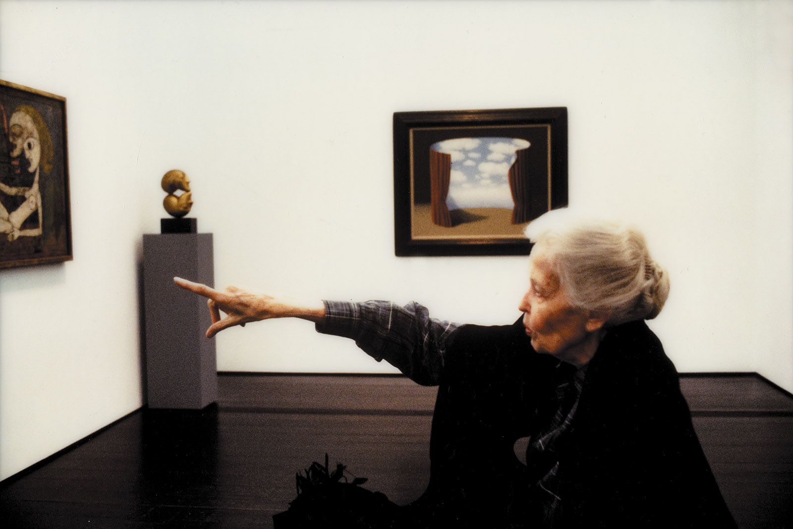 Dominique de Menil with artwork by Magritte and others, at the Menil Collection, Houston, 1990