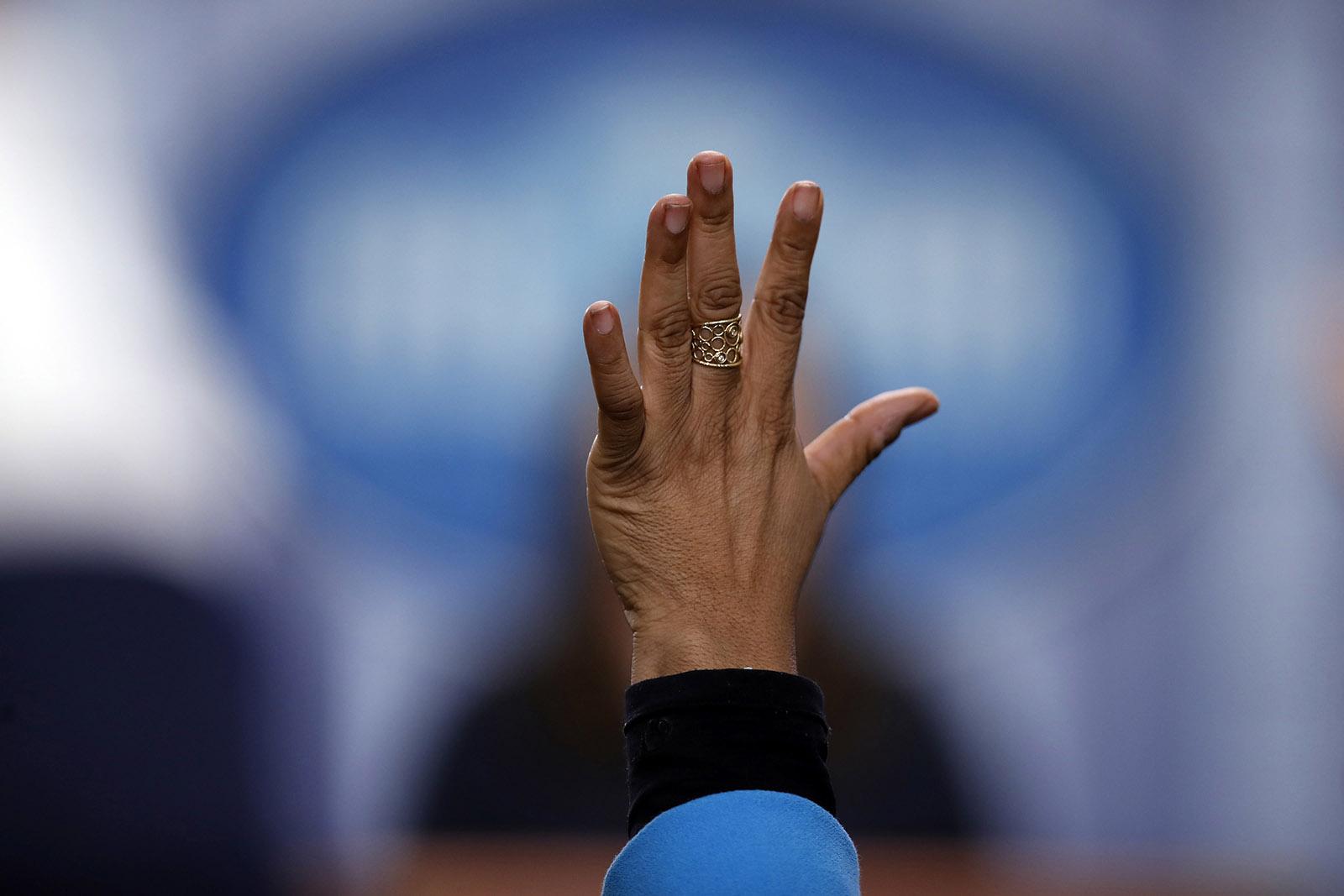 April Ryan raising her hand to put a question to White House press secretary Sarah Huckabee Sanders, Washington, D.C., October 31, 2017