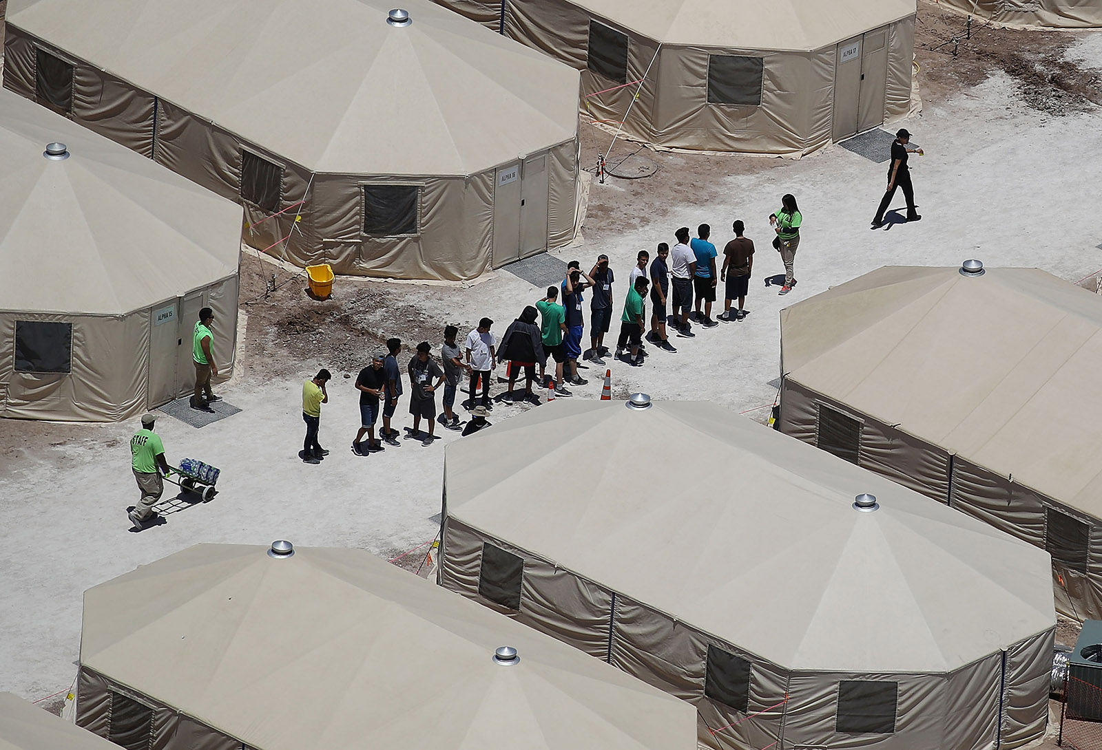 Children and staff at the Trump administration's tent facility for detaining migrant children separated from their parents, Tornillo, Texas, June 19, 2018