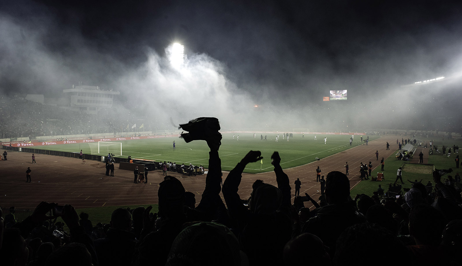 """The """"ultra"""" fans of Raja Casablanca lighting torches at a game in the Mohammed V stadium, Morocco, November 25, 2018"""