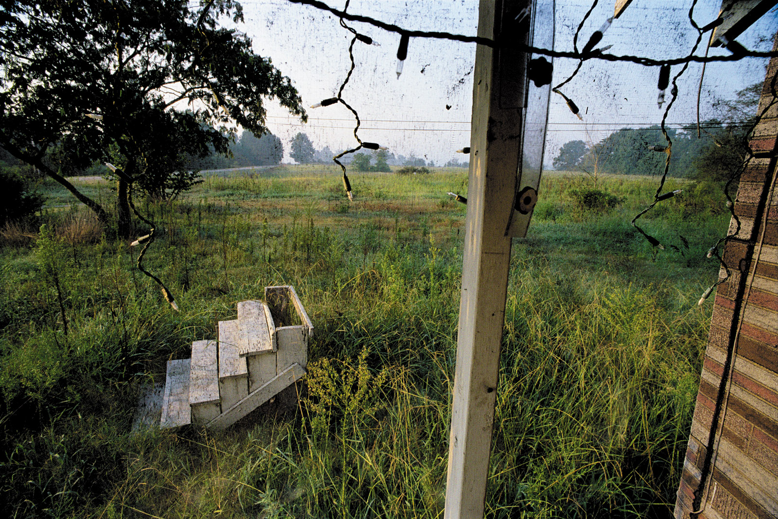 An abandoned farmhouse, 2005; photograph by Eugene Richards from The Run-On of Time, the catalog of a recent exhibition that originated at the George Eastman Museum and the Nelson-Atkins Museum of Art. It is distributed by Yale University Press.