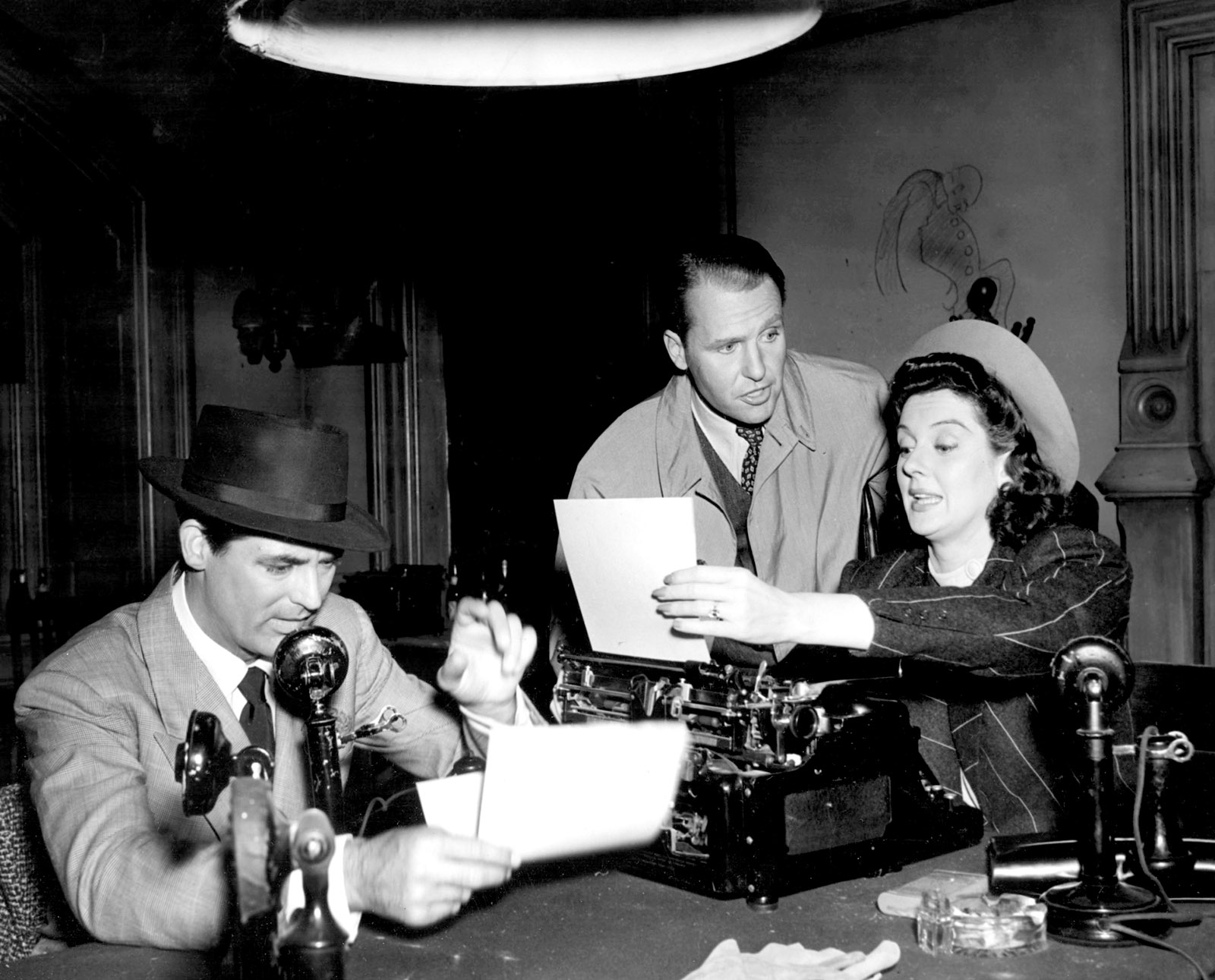 Cary Grant, Ralph Bellamy, and Rosalind Russell in His Girl Friday, 1940