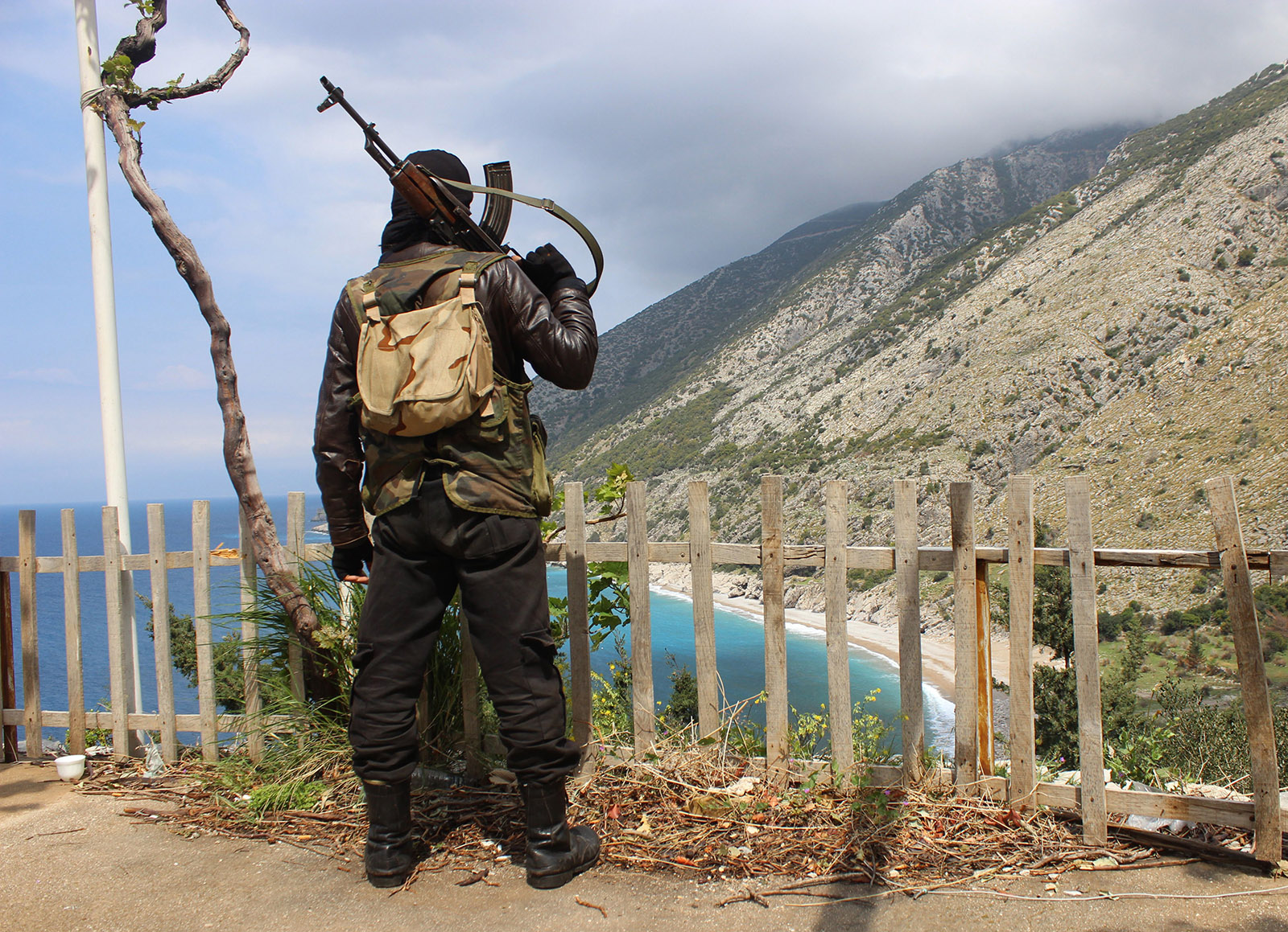 A fighter from the Ansar al-Sham brigade standing on a ridge in the northwestern Syrian province of Latakia during a rebel offensive against regime positions in the coastal heartland of President Bashar al-Assad's Alawi sect, 2014