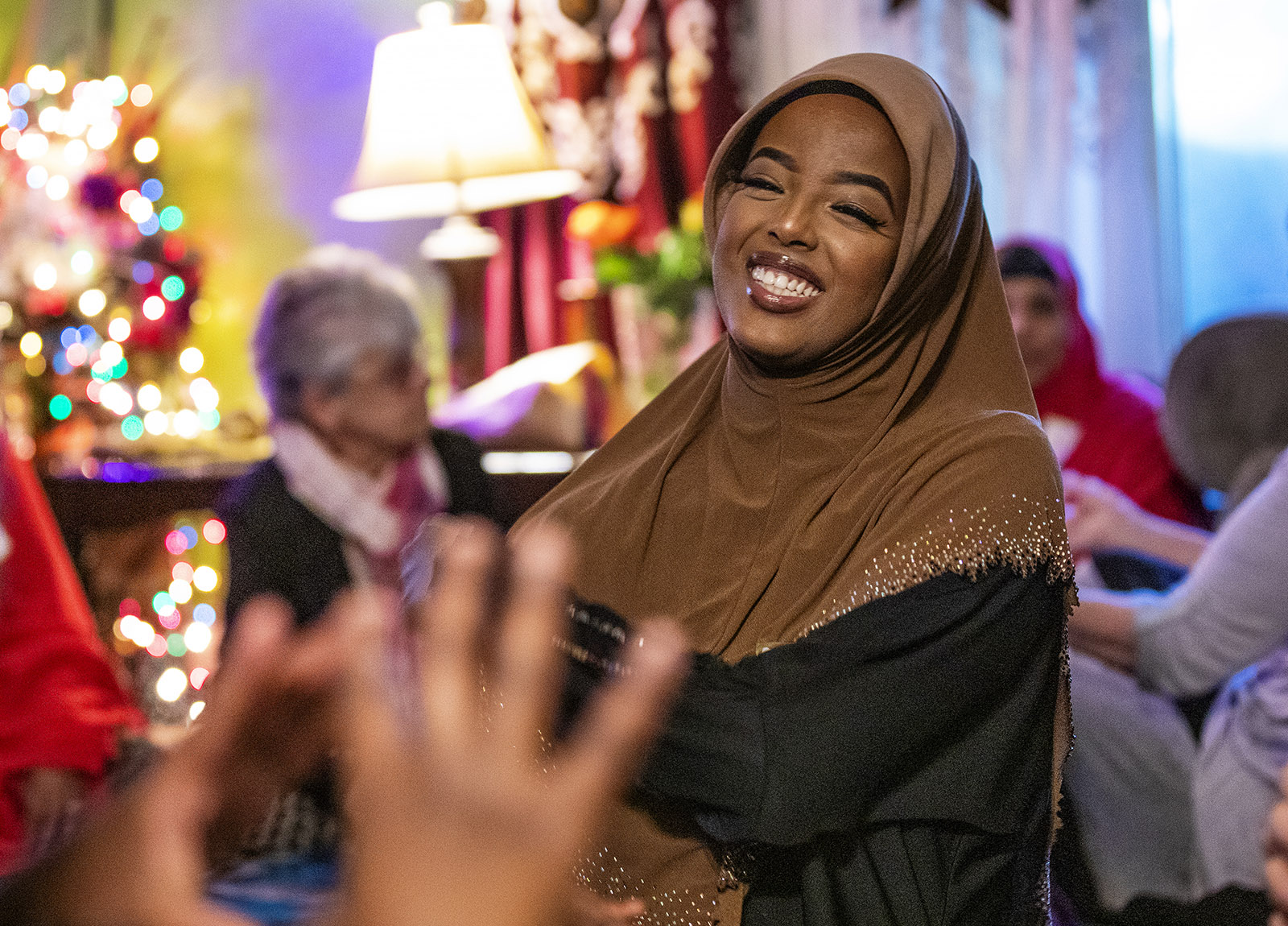 Fosia Omar, a student at St. Cloud State University, enjoying conversation with friends as they waited for the sun to set so that they could break fast, Waite Park, Minnesota, May 25, 2018