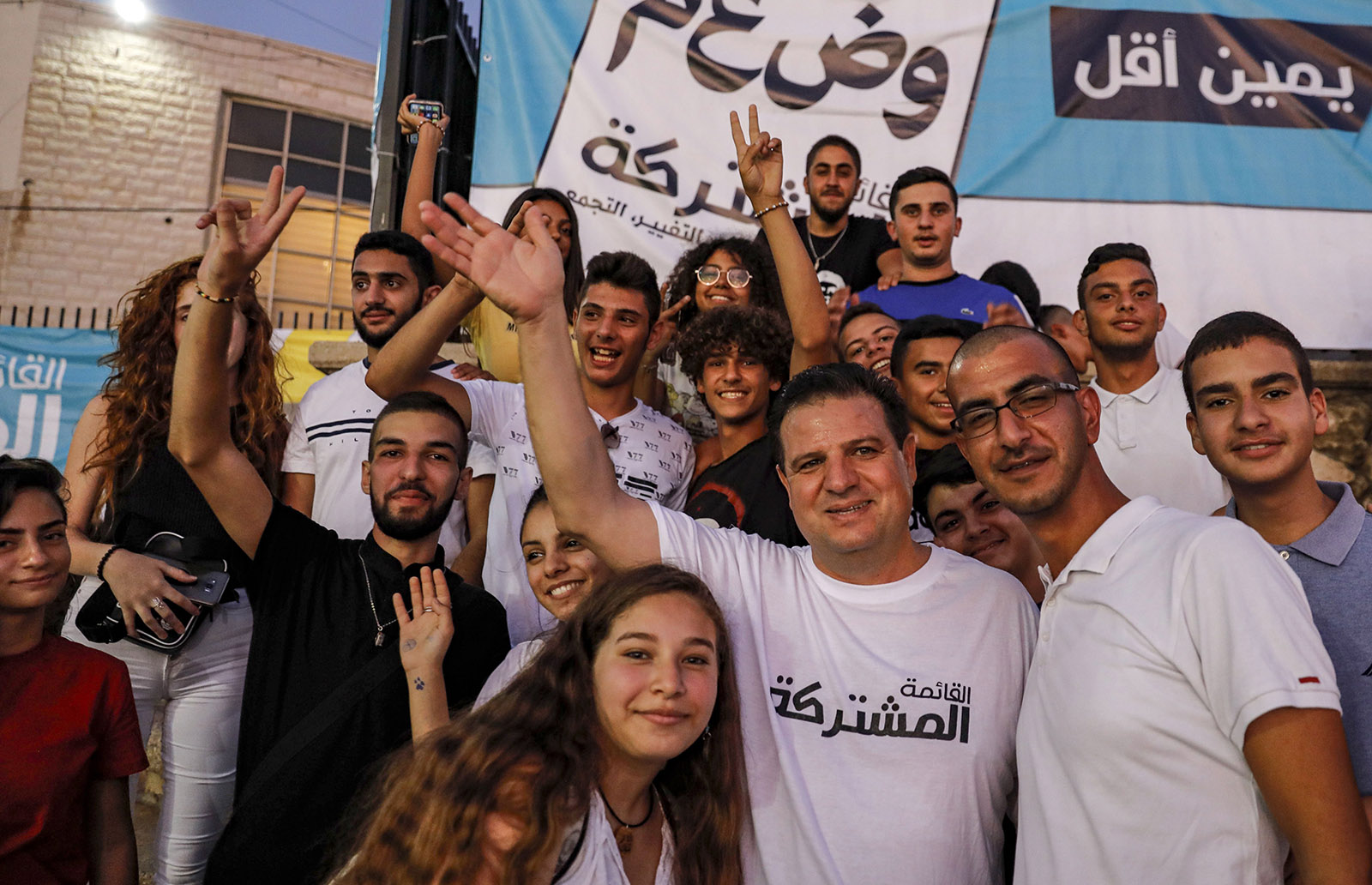 The Israeli-Arab politician Ayman Odeh (front, third from right) at a campaign rally for the Joint List alliance of Arab parties ahead of Israel's September election, Kafr Yasif, Israel, August 23, 2019