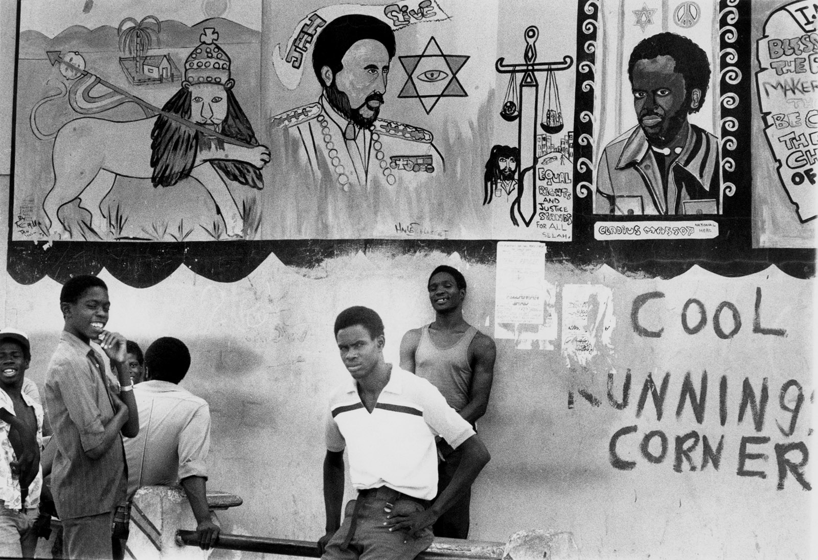 Men standing in front of a Rastafarian mural, Kingston, Jamaica, 1983