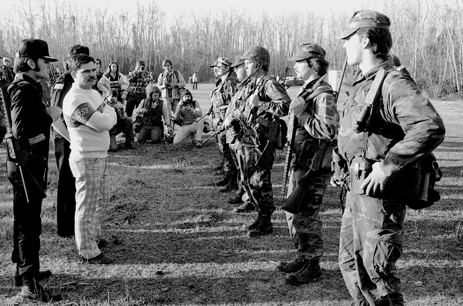 Louis Beam, the Grand Dragon of the Texas Knights of the Ku Klux Klan, inspecting his security forces before a rally against Vietnamese immigrant fishermen along the Gulf Coast, Santa Fe, Texas, 1981