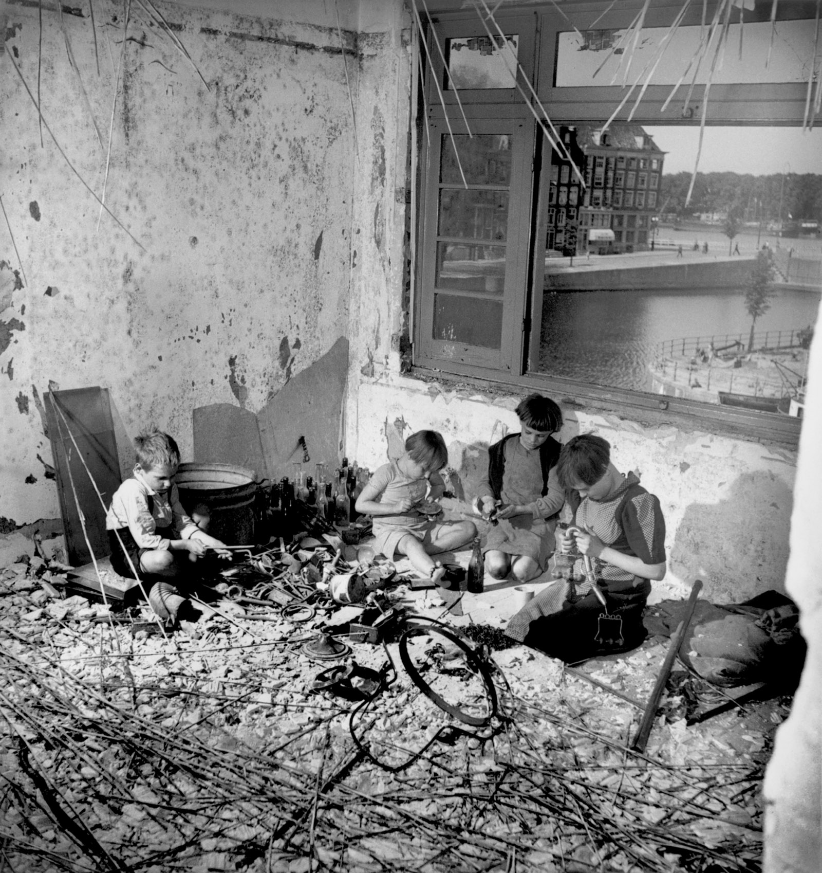 Children in the rubble of a house destroyed during World War II, Amsterdam, 1945