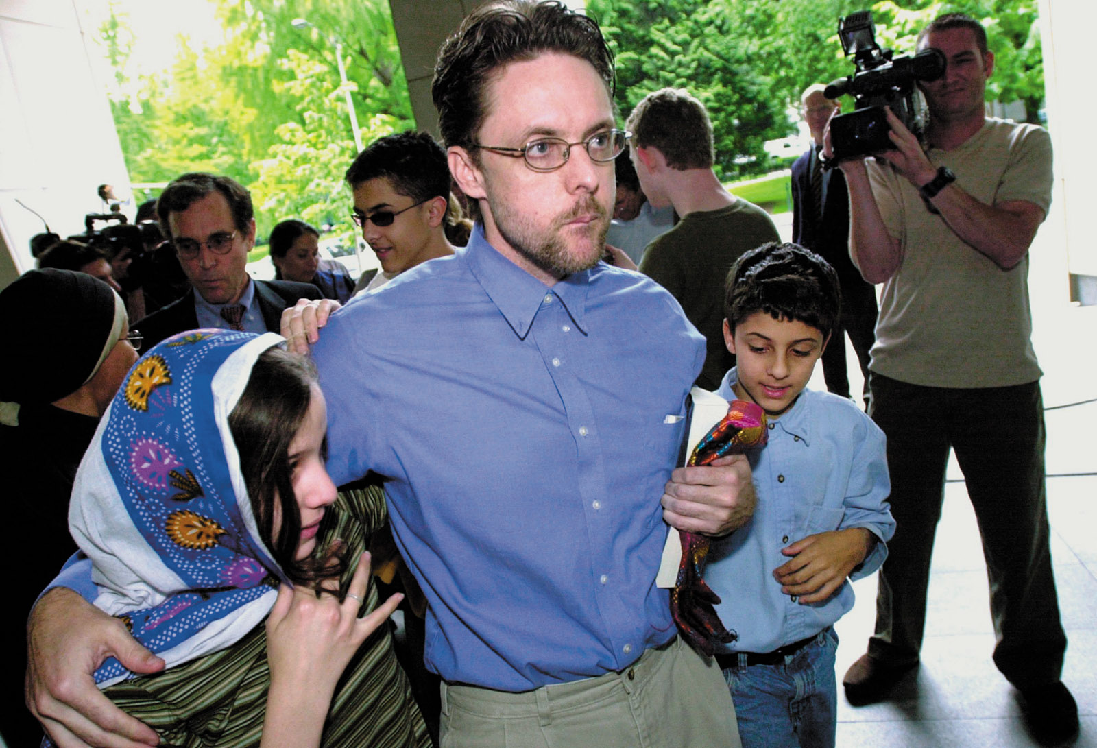 Brandon Mayfield and his children outside a federal courthouse after his release from custody, Portland, Oregon, May 2004.