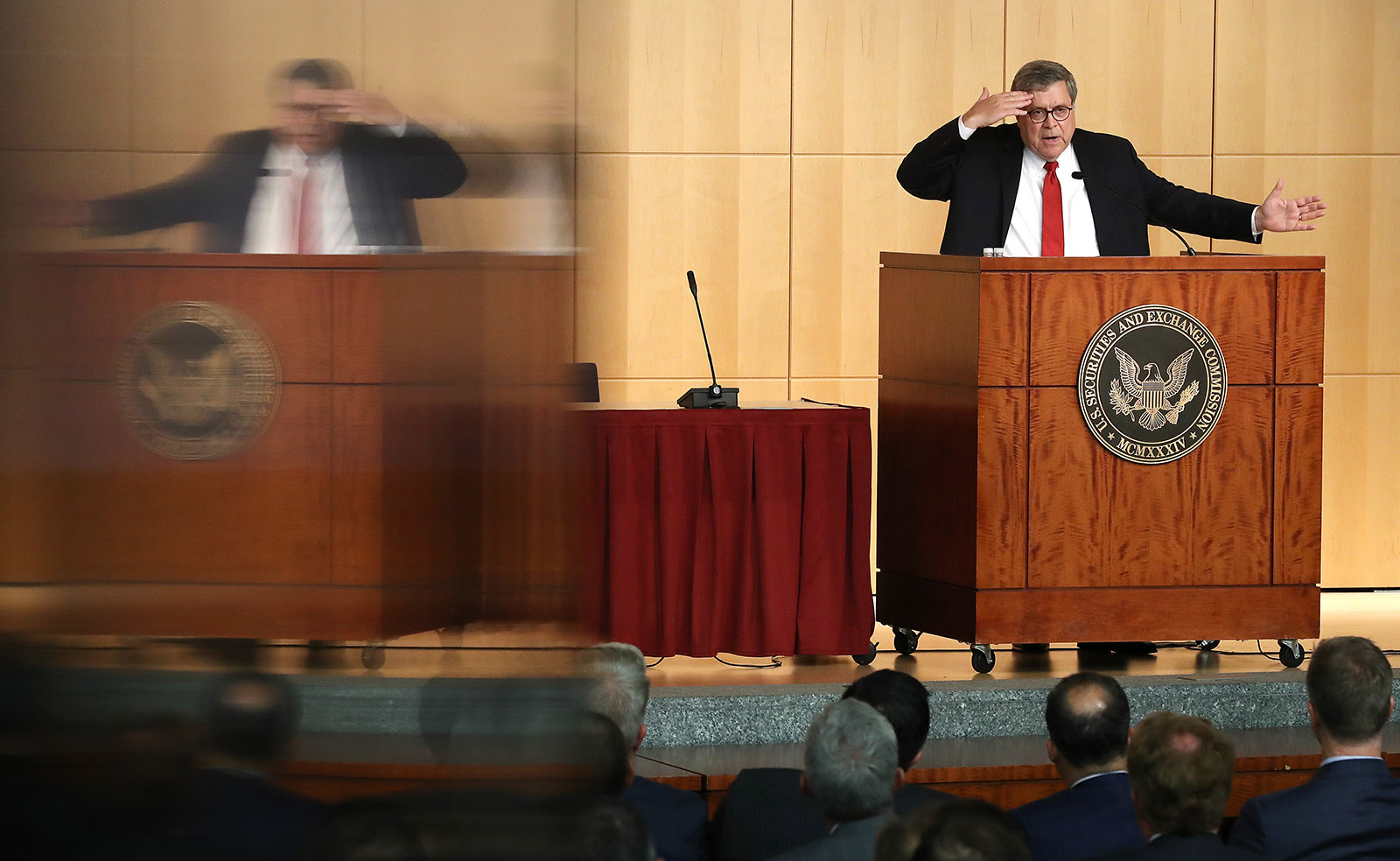 AG William Barr speaking at the SEC