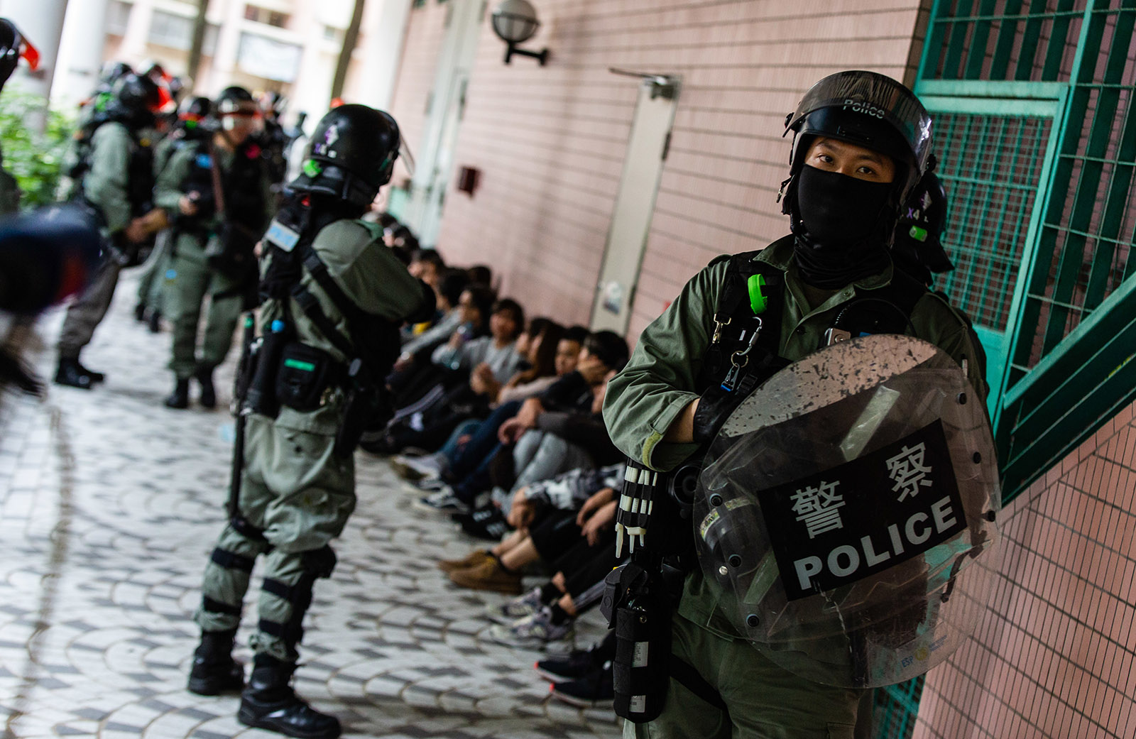 Police in riot gear rounding up suspected protesters, Hong Kong